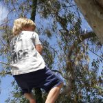 Boy climbing up a tree in Casa Tekne at Family Retreats Ibiza