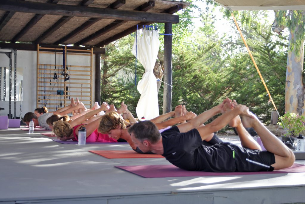 Stretch lesson in our gym at Tekne fitness retreats Ibiza