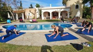 Flexibility training by the pool Tekne Retreats Ibiza.
